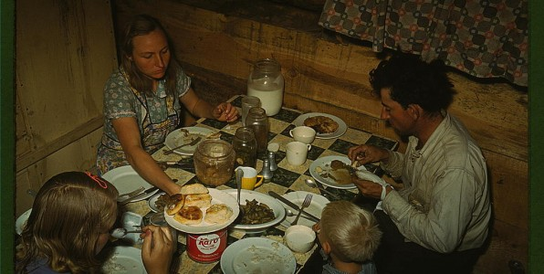 Faro Caudill family eating dinner in their dugout, 1942 Pie Town, NM (LOC) Photo by Russell Lee. Public Domain