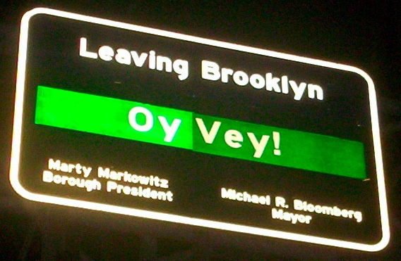 Sign leaving Brooklyn on Williamsburg Bridge -- Oy vey! Leaving Brooklyn! Creative Commons Attribution ShareAlike 2.0. Picture by gill from Glasgow, uk (http://www.flickr.com/people/21324809@N00)