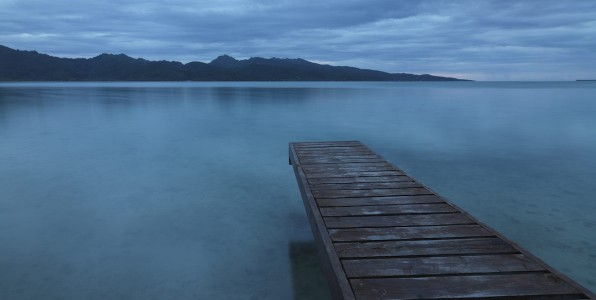 Tranquility. Lonely Pier towards Tahaa Island